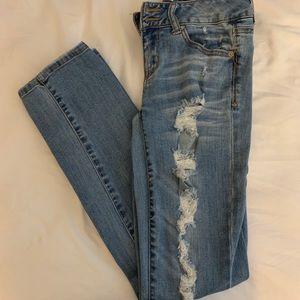 Pants - Distressed skinny jeans